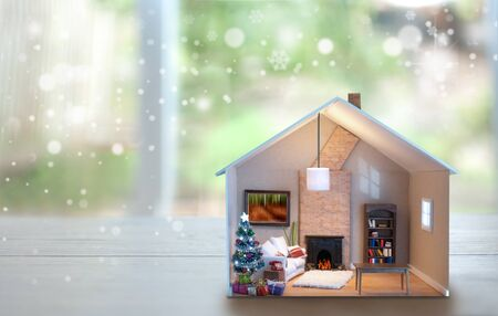 Model house with christmas day tree and presents