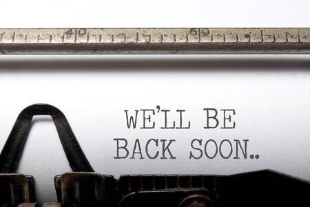 We'll be back soon typewriter headline closeup