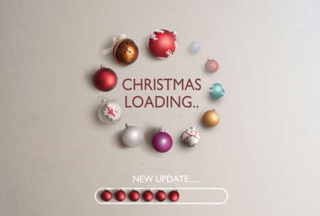 Baubles in the shape of a page loading icon with christmas loading banner in the centre and new update