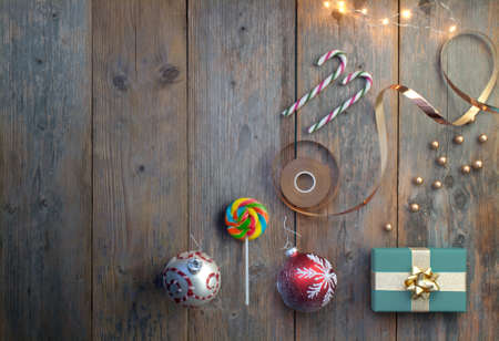 Christmas accessories including gift box, baubles and candy with spac for text Standard-Bild