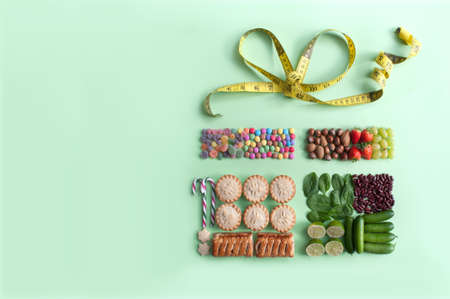 Healthy food and christmas diet side by side in a gift box shape with tape measure bow