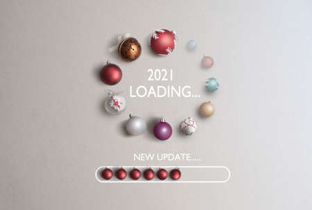Baubles in the shape of a page loading icon with 2021 in the centre and new update