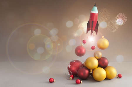 Toy rocket take off, with red and gold christmas baubles Standard-Bild