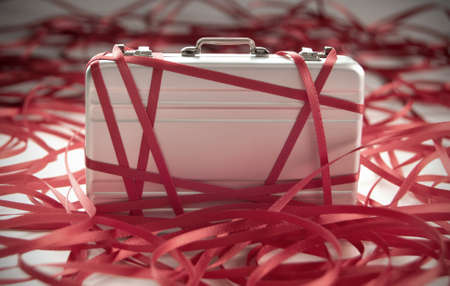Red tape around a briefcase labeled tax