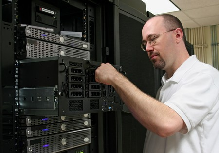 administrators: Computer Techniciannetwork administrator working on a server.