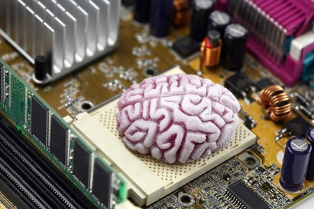 data processor: Concept image of a brain acting as the CPU on a computer motherboard.