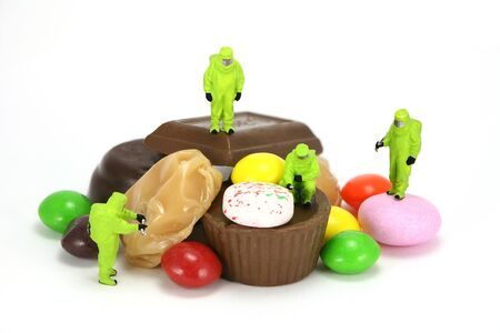 hazardous material team: Concept images of a HAZMAT team (Hazardous Materials) inspecting some candy. It represents how candy and junkfood can be hazardous to someone on a diet.