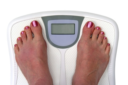 weight scale: Feet on a bathroom scale. Sceen is blank so you can enter your own numbers or text. Isolated.  Includes clipping path.