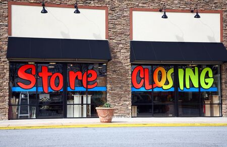 The front of a store that is going out of business. The words
