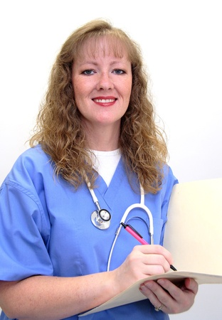 care giver: Nurse with long blonde hair wearing a stethoscope and scrubs. She is also holding a medical chart. Isolated on white. Stock Photo