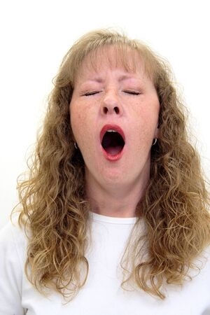 Caucasian woman yawning with her mouth wide open. Isolated on white. Stock Photo - 9114874