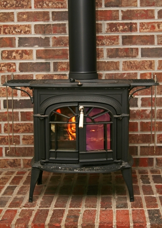 Old fashioned wood burning stove on a brick base photo