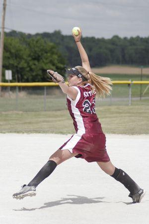 Teenage girl playing softball. Фото со стока