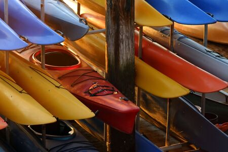 A rack full of kayaks waiting to be used Stock fotó