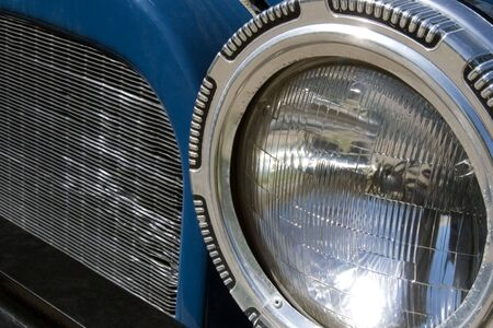 A close-up, abstract look at an old cars headlamp