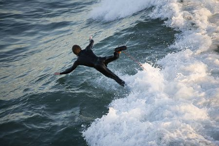A surfer wipes out on a gnarly wave.