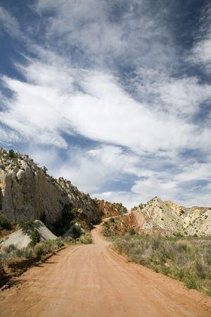 A red road through some Utah hills Stock fotó