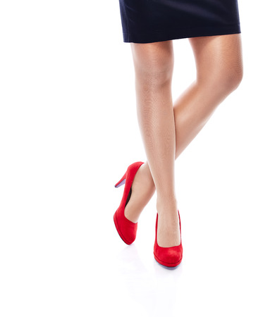 Close Up Legs of woman in heels isolated on white photo