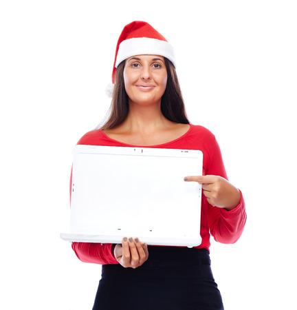 white laptop: Donna in abito di Natale Mostrare portatile bianco