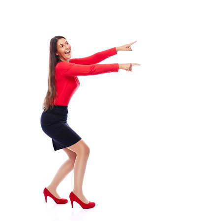 Business woman wearing red pointing sideways is excited isolated on white background photo