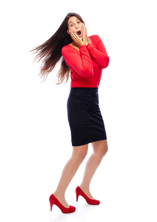 Woman in red is shocked isolated on white photo