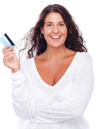 Portrait of a young woman holding credit card photo