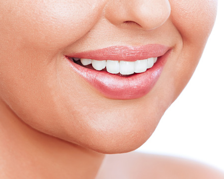 teeths: Closeup image of a young womans lips and teeths