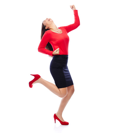 Business Woman in red celebrating doing the Winner dance photo
