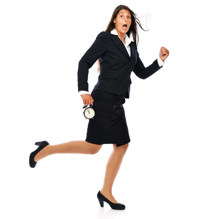 Business woman running, is short on time - getting late. Isolated on white background.  More of her - click here:  photo