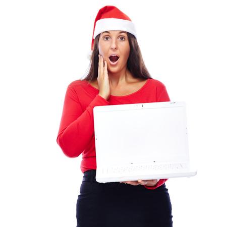 white laptop: Donna in abito di Natale Mostrando Bianco Laptop Archivio Fotografico