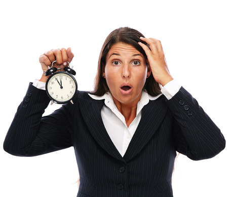 getting late: Business woman holding a clock that shows 5 to 12. Concept for stress or getting late. Isolated on a white background.   Stock Photo