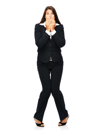 Business woman biting her nails is nervous and scared.    Isolated on a white background.  photo