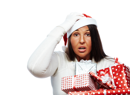 christmas debt: Young santa woman is busy, has christmas stress or forgot something Stock Photo