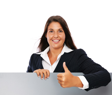 Business woman showing thumbs up with a blank grey sign.    Isolated on a white background. photo