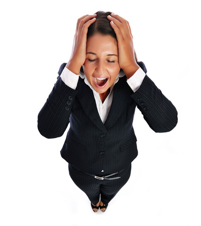 Business woman is screaming has headache.    Isolated on a white background.  photo