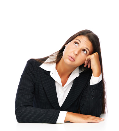 Business woman is bored looking uowards.    Isolated on a white background. photo