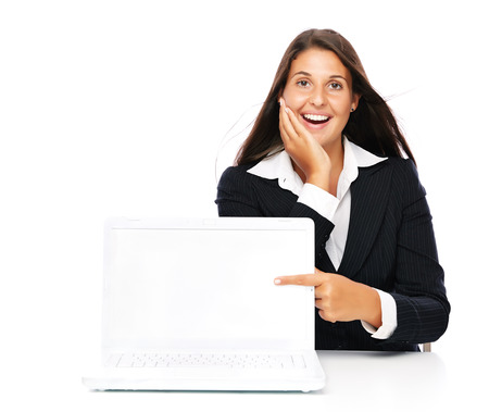 Business woman excited pointing at empty white laptop.   Isolated on a white background.  photo