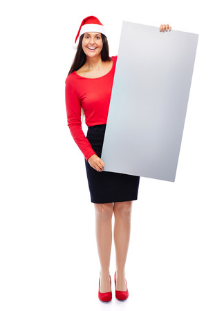 Business woman with santa hat holding blank empty grey sign isolated on white photo