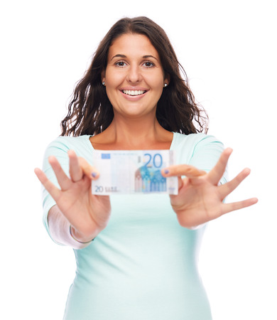 Young amazed female Holding 20 Euro bill into Camera, Cheerful Smiling photo
