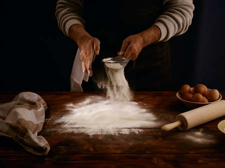 Image of a chef sieving the flour