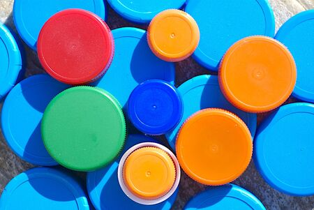 disposed:  Group of disposed multicolored plastic caps. Lots of garbage!  Stock Photo