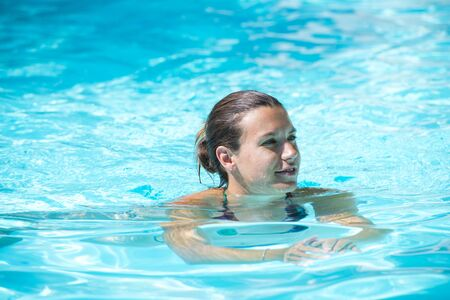 Young woman swimming at the pool Standard-Bild