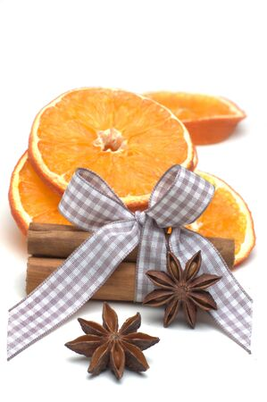 christmas scent: Isolated orange slices, cinnamon sticks and star anise with bow