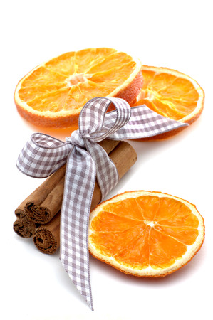 Isolated orange slices, cinnamon sticks and star anise with bow