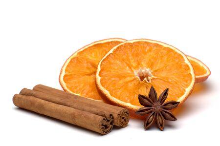 cinnamon sticks: Isolated orange slices, cinnamon sticks and star anise with bow