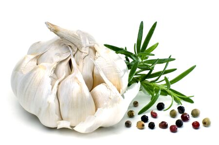 macroshot: Garlic with rosemary, pepper and spices isolated against white