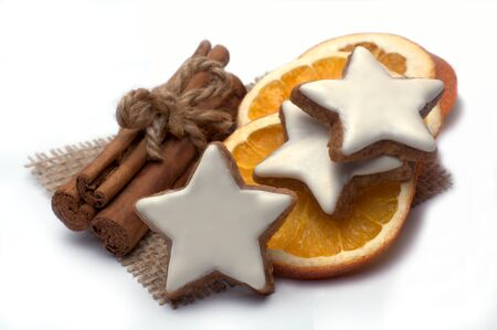 macroshot: Cinnamon stars with Christmas spices isolated on white
