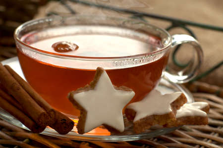 christmas motif: Hot tea with cinnamon stars Stock Photo