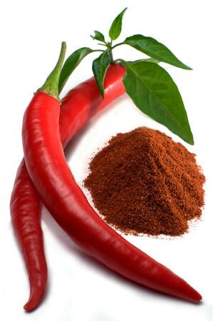 chili powder: Red chili peppers with leaves and chili powder isolated