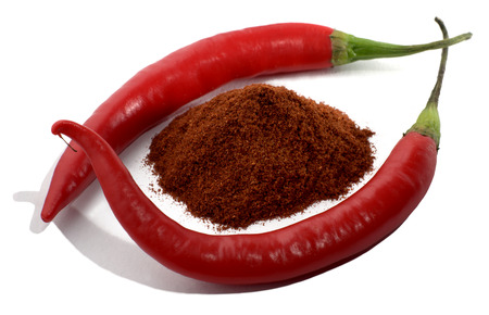 chili powder: Red chili peppers and chili powder isolated on white